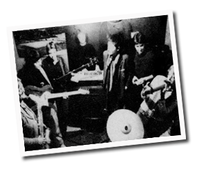 Black and white photo of Bright Girls playing keyboard, guitar, drums and singing.