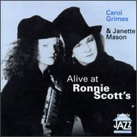 An ad showing Janette Mason and Carol Grimes posing with hats on, for a gig 'Alive at Ronnie Scott's' jazz club.