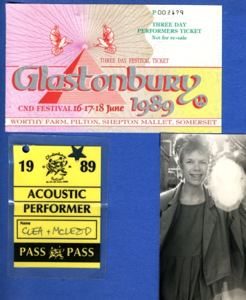 A page from Cinders' scrapbook showing a ticket to the group's performance, a backstage pass, and a hazy photo taken at the event.