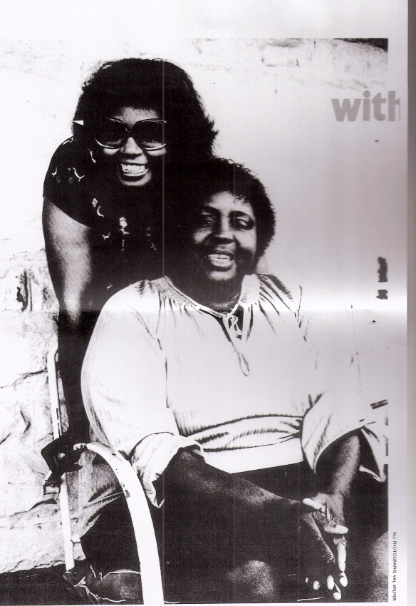 Black and white photo of Fontella Bass leaning over her seated mother Martha, both smiling, accompanies interview
