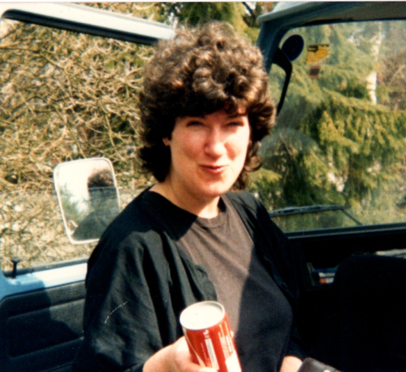 A casual shot of Aviva on the road, in a car, smiling and drinking Coke
