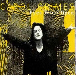 The front cover of Carol Grimes' album shows a black and white photo of her with her arms outspread in a welcoming gesture, smiling, against a yellow background of draped abstract shapes. 'Eyes Wide Open, Carol Grimes.'
