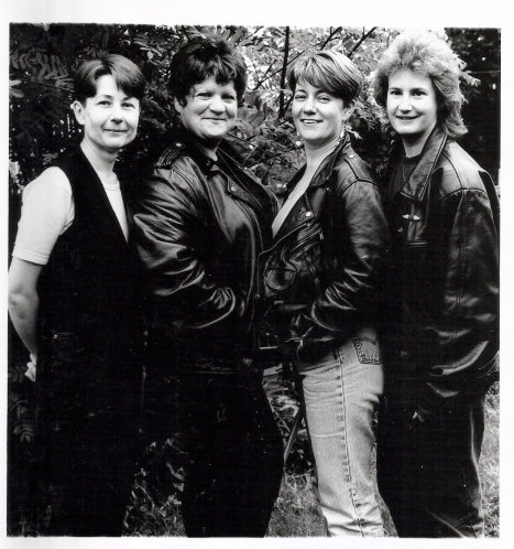 The four members of the Fab Jam Tarts in a publicity shot, smiling.