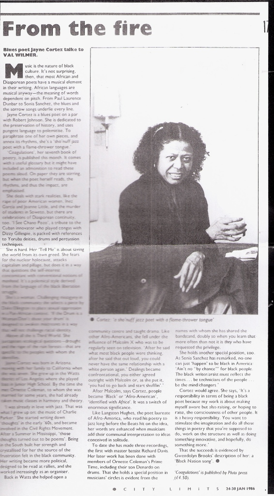 1986 Val Wilmer interview with African-American jazz poet Jayne Cortez, on the importance of Jayne in Black history and culture. Illustrated with black and white photo of Cortez, seated, looking intently at camera.