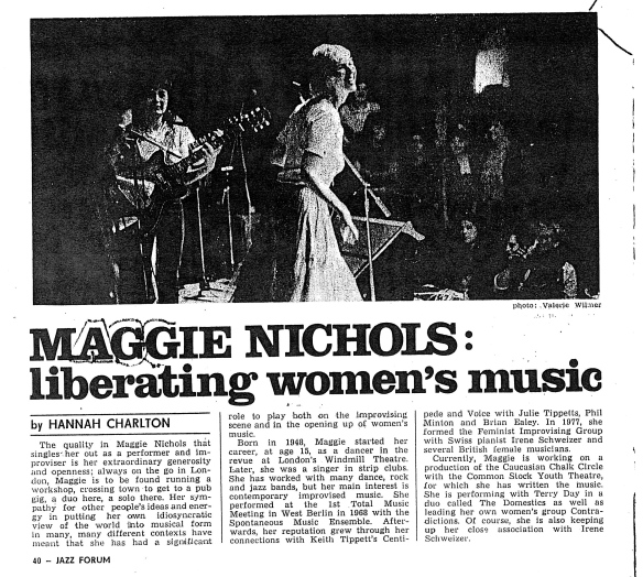 Newspaper clipping headed 'Maggie Nicols: liberating women's music.' The interview outlines Maggie's career, beginning by noting the 'quality as a performer and improviser' that marks her out, ' her generosity and openness; always on the go, running a workshop, a pub gig, a duo here, a solo there.' In the accompanying photo of Maggie singing on stage, with guitarist Sally, a rapt women's audience watches.
