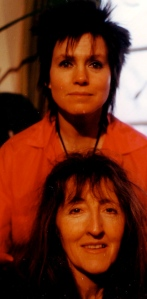 A posed publicity colour shot of Dee and Rosemary smiling at the camera.