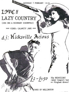 'Live! Lazy Country, Calamity Jane video. DJ Hicksville Acious. £2/1.50, 50p reduction wear cowgirl hat or gingham dress.' Black and white flyer illustrated with drawings of 2 women, one in a cowboy hat aiming a rifle, the other drawing a pistol from a holster, in keeping with the band's country and western pastiche style.