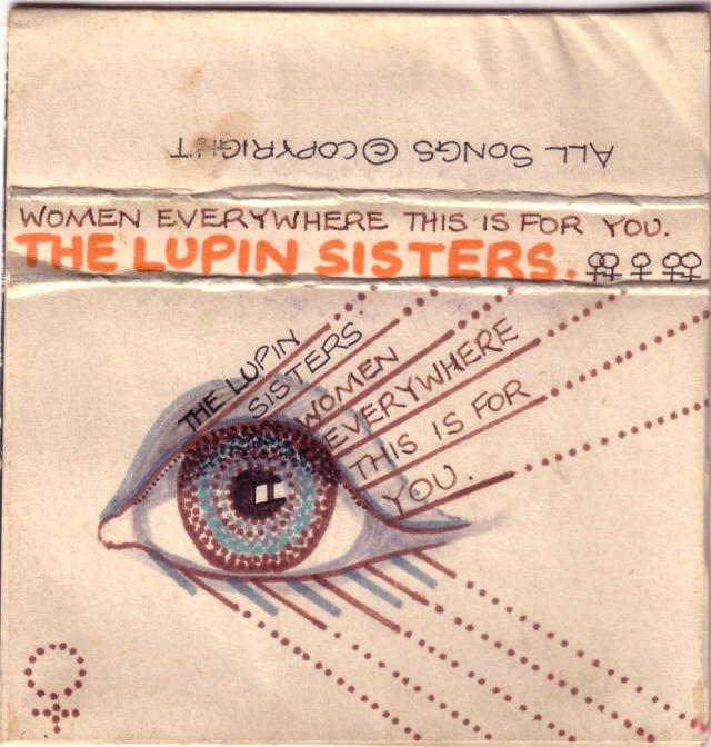 Hand drawn cassette cover for the Lupin Sisters 'Women Everywhere this is for you,' picture of an eye with the title emerging from its centre, and hand drawn women's symbols.