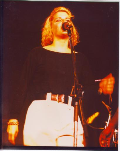 Singer on stage with microphone, from the same gig as other photos, showing the band really lively and energetic in performance.