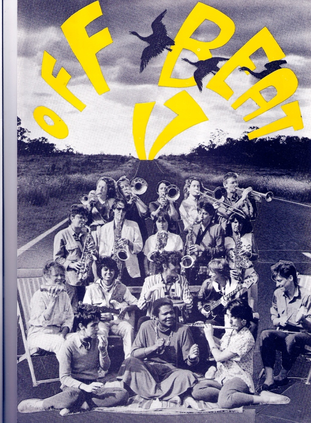 Poster using yellow bubble letters saying 'Offbeat 17' on a blue and white photo of band posing in a road which leads off into the distance behind them, playing and/or smiling, with their instruments. Women playing brass instruments standing in back rows, guitars and percussion in front.