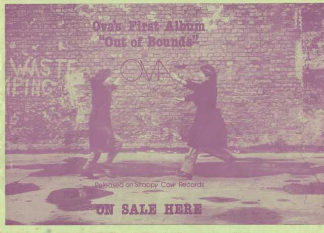 """Picture of Jana and Rosemary running excitedly toward each other. Backdrop is a brick wall, a piece of graffiti with the word 'waste' is on the wall. Information about the album, 'Ova's first album, """"Out of Bounds"""", released on Stroppy Cow records. Red tinted image on greenish background."""