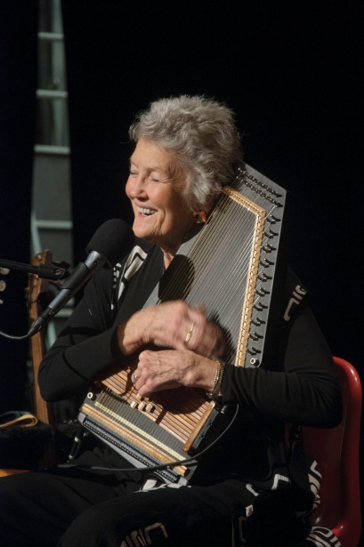 Peggy in concert, singing and playing dulcimer.