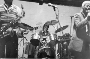 Saxophonist, drummer, singer playing .