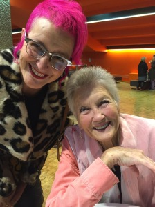 Peggy smiling after concert at Barbican, Rachael House with arm around her shoulder, both smiling.