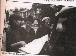 Four members of the Siren group photographed with their van and consulting a map.