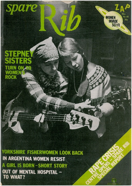 The cover of Spare Rib is a black and white photo of two of the Stepney Sisters seated together, with Benni the bass player leaning over to show Nony something on the guitar fretboard. The text, in bright green, says 'Stepney Sisters. Turn on to women's rock.' Other articles within are listed. 'Yorkshire fisherwomen, Argentinian women's resistance, the experience of leaving mental hospital, a special report on a new Rape Crisis centre, and women's science fiction.