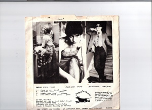 Back cover of the E.P. record, Stereotyping, uses 3 posed photos of band members dressed as stereotypes: housewife with child washing up, skimpily dressed in fishnet stockings, butch woman in suit. Four tracks are listed: Friend in You, Isolation, Stereotyping and Song About Myslelf, all penned by Terry Hunt. 1981 Stroppy Cow Records.