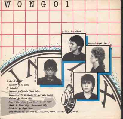Four passport size photos of the band, super imposed over a clock face. Track info: 'Beat the Clock', 'Undecided', recorded at the Workhouse, produced by Tour de Force, distributed by Rough Trade.
