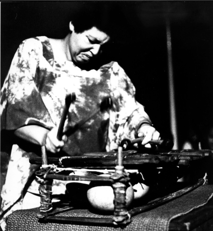 Terri Quaye performing solo in farewell concert at Africa Center 1982, playing balathon, an African instrument akin to axylophone.