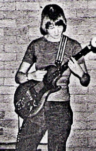 Alain (surname unknown) playing guitar rehearsing for a gig at the First National Lesbian conference in 1974. Not a lesbian herself, she supported the cause