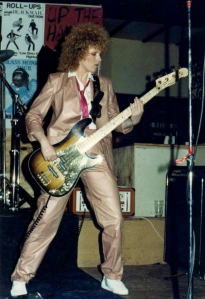 Bernice playing bass guitar at a Tour de Force gig