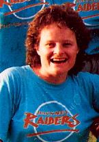 Colour photo of Shauna smiling in her Hackney Raiders baseball team teeshirt