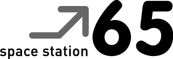 The logo includes an arrow pointing upwards and the words 'space station 65'